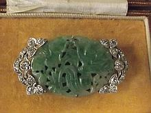 A superb carved jade diamond set white gold brooch