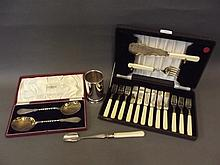 A pair of cased silver plated spoons, a silver
