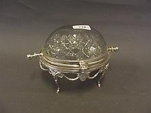 A silver plate and cut glass roll over bon bon