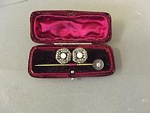 A diamond set stick pin, and a pair of marcasite
