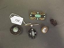 A 15ct gold bar brooch set with an opal, a cameo