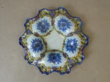 A Portuguese faience dish with shaped rim and floral decoration, 13