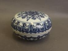 A Chinese blue and white porcelain circular pot and cover with painted Yin & Yang decoration, 6 character mark to base, 5