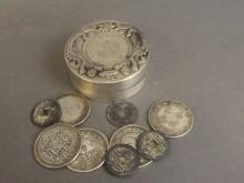 A Chinese white metal ink pot with inset coin and twin phoenix decoration, together with a collection of nine assorted facsimile Chinese coins, 3