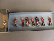 A boxed set of eight Britain cast models 'The Band of Coldstream Guards', together with a boxed Britain model of a lifeguard made for Harrods