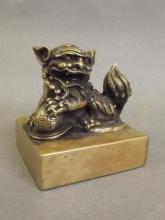 A Chinese square form bronze seal with kylin and puzzle ball surmount, 3