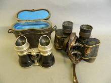 A pair of early German brass cased field glasses by Goerz, together with another pair of early field glasses, in original case, 5