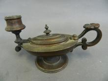A bronze chamber stick in the form of a Greco-Roman oil lamp, the body housing a vesta box, 7