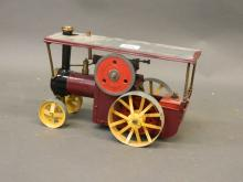 A scratch built working model of a steam tractor, 12