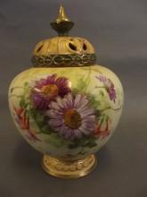 A Royal Worcester pattern bulbous potpourri vase and cover painted with summer flowers and gilt highlights, 9