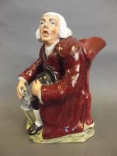 A C19th Staffordshire Toby jug in the form of a lamp lighter, 9