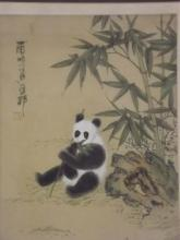 A Chinese watercolour on silk of a panda amongst bamboo, with calligraphy and red seal mark, 8