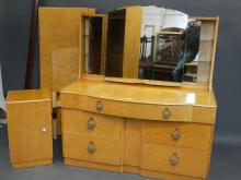 A 'Wrighton' mid C20th satin birch dressing table, together with matching double bed and pot cupboard