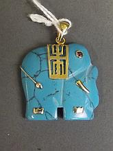 A Chinese turquoise stone pendant carved in the