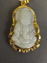 A Chinese celadon jade pendant carved in the form