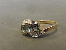 A 9ct gold three topaz and diamond set dress ring,