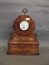 A Regency brass inlaid rosewood mantle clock