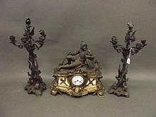 A 19th Century French brass and bronzed three