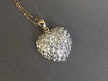 A 9ct gold pave diamond heart shaped pendant and