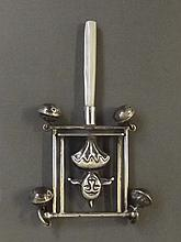 A child's silver rattle in the form of a jester