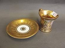 A Continental gilt ground cabinet cup and saucer