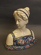 A Longwy style pottery bust of a maiden, 10¼''