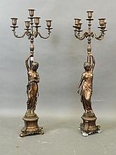 A pair of bronze five branch candelabra in the