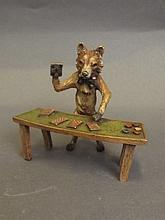 A cold painted bronze model of a fox croupier,