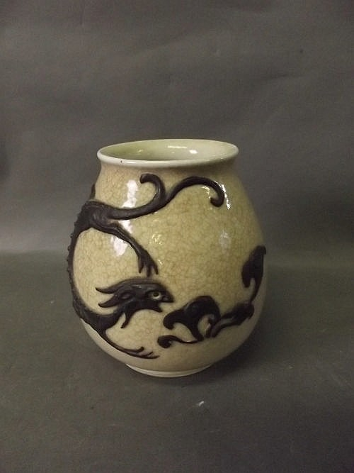 A Chinese vase decorated with an applied dragon,