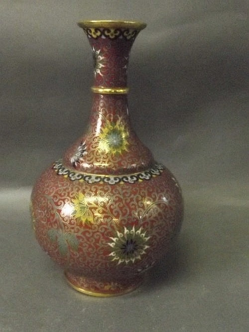 A Chinese cloisonné vase decorated with stylized