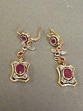 A pair of 9ct gold, oval ruby and diamond set drop