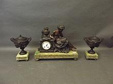 A C19th French onyx and bronzed three piece clock