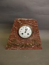 A French Art Deco mantle clock with applied brass