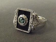 A 14ct white gold emerald, diamond and onyx Art
