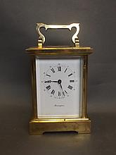 A large brass carriage clock made by Bravingtons,