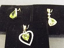 Three 9ct gold peridot and diamond pendants