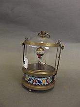 A brass and cloisonné automaton clock in the form
