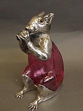 A silver plate and cranberry coloured glass claret