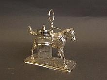 A silver plated cruet set in the form of a dog,
