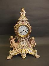 A large Continental pottery mantle clock decorated