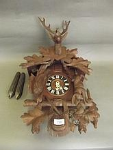 A C19th carved wood Black Forest cuckoo clock with