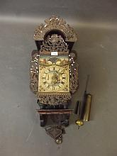 A large C19th Dutch brass and wood wall clock with