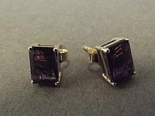A pair of 9ct gold square cut amethyst ear studs