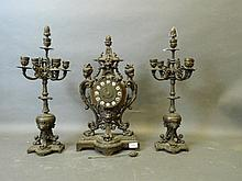 A C19th Continental bronze clock and matching pair