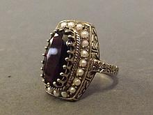 A 9ct gold garnet and seed pearl ring, size P