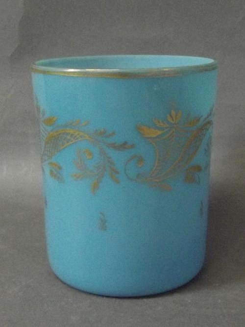 An opaline blue ground glass beaker with gold