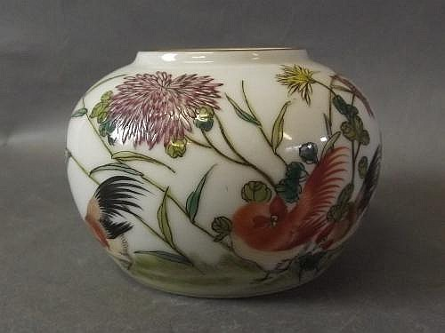 A small Chinese vase decorated with cockerel