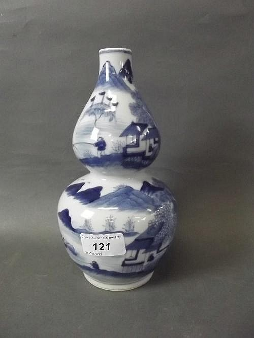 A Chinese blue and white double gourd vase painted