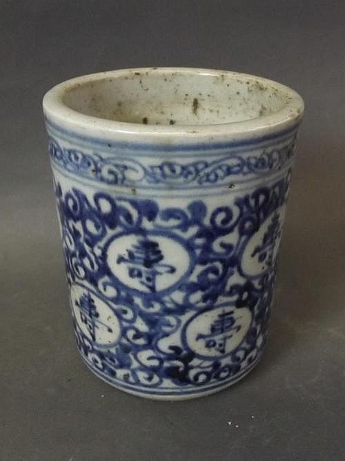 A Chinese blue and white brush pot decorated with