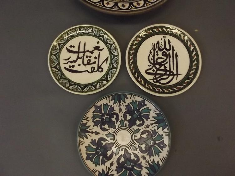 A North African Glazed Terracotta Bowl And Three Plates Dec